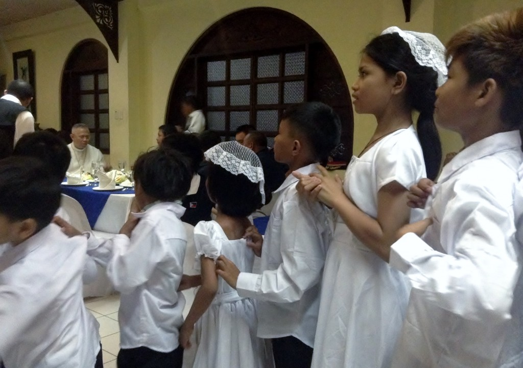 Children receiving first communion